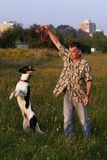 Playing With Dog. Man and his best friend entertaining each other in the field Stock Images