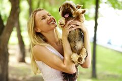 Playing with dog Royalty Free Stock Photos