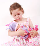 Playing with doll Royalty Free Stock Photography