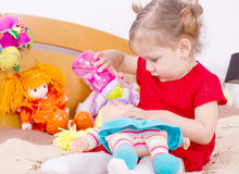 Playing with the doll girl Stock Photo
