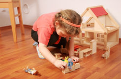 Playing with doll's house stock images
