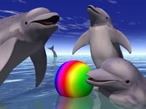 Playing Dolphins. 3D illustration of playing dolphins and a rainbow colored ball Stock Photography