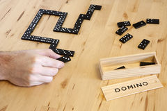 Playing domino game Stock Photo