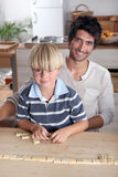 Playing dominoes. Father and son playing dominoes Stock Image
