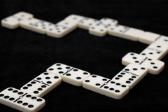 Playing dominoes. White pieces with black dots. Stock Images