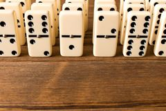 Playing dominoes on a wooden table. Close up. Dominoes game conc. Ept royalty free stock photo