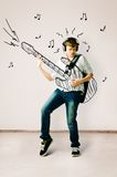 Playing on drawn guitar royalty free stock photography