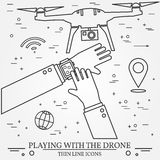 Playing with the drone, copter.  Remote Control with Mobile Phon Royalty Free Stock Image