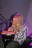 Playing drum. Rock concert: musician with long hair playing drum Royalty Free Stock Image