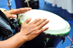 Playing the drum. Focus on the hand and other hand in motion royalty free stock images
