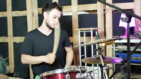 Playing drums in studio. Concept of drummer rock. Repetition of rock music band at rehearsal base. Musician playing the drum set stock footage