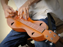 Playing Dulcimer. Playing an Appalachian Dulcimer, 3-string instrument Royalty Free Stock Images