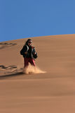 Playing on the dunes. Woman playing on the dunes of the desert (Morocco Royalty Free Stock Image