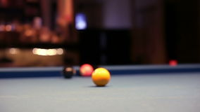Playing Eight-ball pool billiards in a bar. A video of playing Eight-ball pool billiards in a bar stock video footage