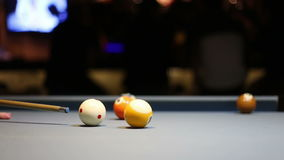 Playing Eight-ball pool billiards in a bar. A video of playing Eight-ball pool billiards in a bar stock footage