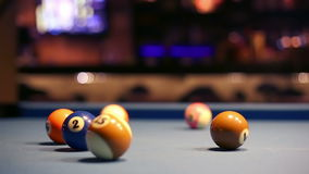 Playing Eight-ball pool billiards in a bar. A video of playing Eight-ball pool billiards in a bar stock video