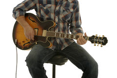 Playing Electric Guitar. Man in check shirt playing guitar Stock Image
