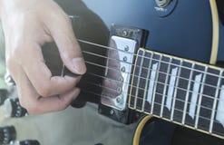 Playing electric guitar close-up. Closeup man playing electric guitar Royalty Free Stock Photography
