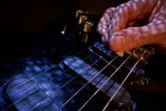Playing electric guitar Stock Images