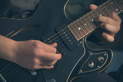 Playing electric guitar. Man playing electric guitar in studio Royalty Free Stock Images