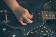 Playing electric guitar - 2. Man playing electric guitar in studio Royalty Free Stock Images