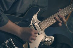 Playing electric guitar - 3. Man playing electric guitar in studio Royalty Free Stock Photos