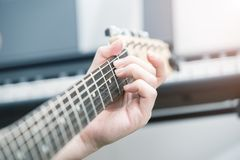 Playing electric guitar royalty free stock images