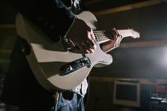 Playing electric guitar in studio closeup stock photos