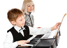Playing electric piano. Mother and her preschool son playing electric piano Royalty Free Stock Photography