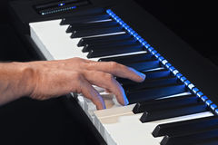 Playing the electric piano by hand Royalty Free Stock Photo