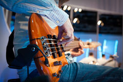 Playing electrical bass guitar Royalty Free Stock Photos