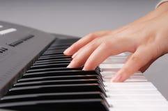 Playing electronic organ Royalty Free Stock Image