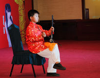 Playing the erhu boy Stock Images
