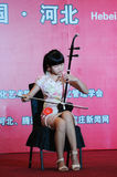 Playing the erhu girl royalty free stock photo