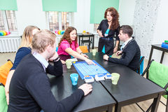 Playing exciting guessing games at party royalty free stock photo