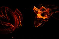Playing with fire on long exposure Royalty Free Stock Photos