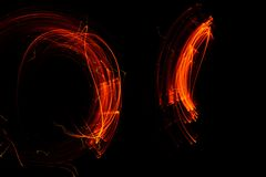 Playing with fire on long exposure Royalty Free Stock Photography