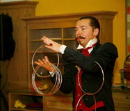 Playing with fire - a Performance by actor the illusionist. the magician a Roman Borsch. Stock Image