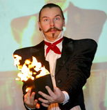 Playing with fire - a Performance by actor the illusionist. the magician a Roman Borsch.. Royalty Free Stock Photography