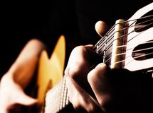 Playing flamenco guitar. Flamenco guitar player close up, playing traditional acoustic guitar concept image us as background, high contrast, selective focus on Royalty Free Stock Photography