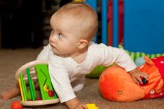 Playing on the floor Royalty Free Stock Photo