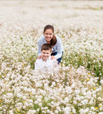 Playing among the flowers Stock Photography