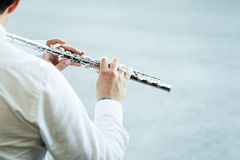 Playing flute Stock Images