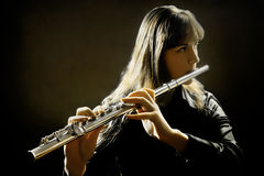 Playing flute player Royalty Free Stock Image