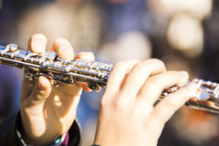 Playing the flute / Suonando il flauto Royalty Free Stock Image