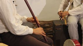 Playing at flutes Royalty Free Stock Image