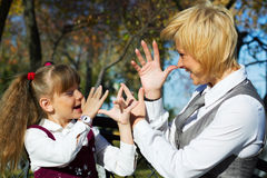 Happy mother and daughter in autumn park Royalty Free Stock Photography