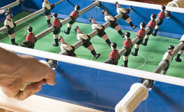 Playing Foosball. One Person playing Table Soccer with red and white Dress Royalty Free Stock Images