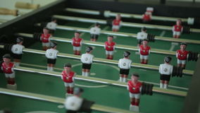 Playing foosball. steadicam shot. Close up stock video footage