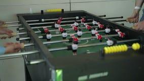 Playing foosball. steadicam shot. Close up stock video